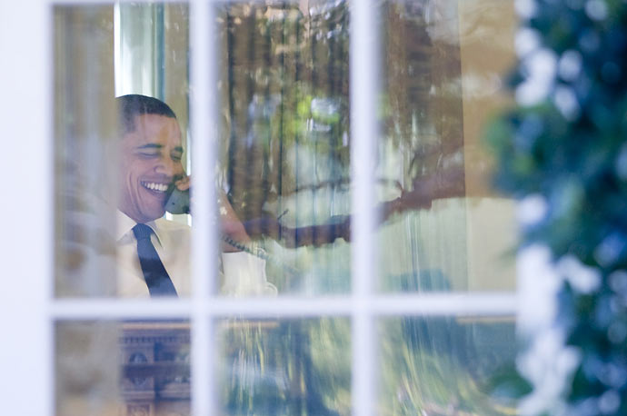 President Obama speaks on the phone in the Oval Office after being awarded the Nobel Peace Prize.