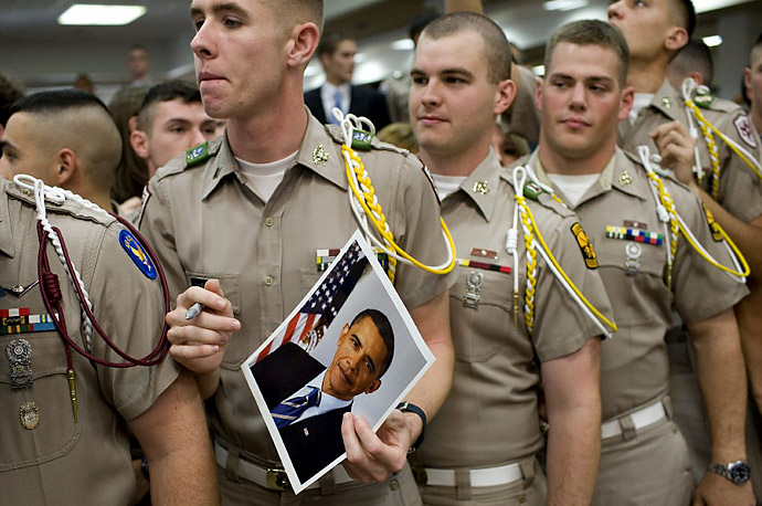 Corps cadets listen as President Barack Obama addresses them in a cafeteria at Texas A&M University in College Station, Texas.