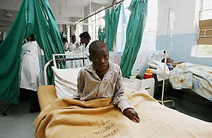 A Zimbabwean cholera patient sits in his bed on February 27, 2009 at a hospital in Harare.
