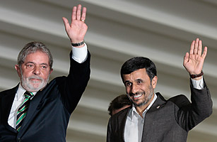 Iran's President Mahmoud Ahmadinejad (right) and Brazil's President Luiz Inacio Lula da Silva wave to journalists at the Itamaraty palace in Brasilia