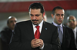 Lebanon's Prime Minister Saad al-Hariri pays father, assassinated former Lebanese Prime Minister Rafik al-Hariri, in Beirut new unity government on Monday that iministers Hezbollah.