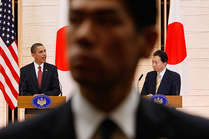 A Japanese security official stands watch at the official residence of the Japanese Prime Minister Yukio Hatoyama during a joint news conference with President Obama.