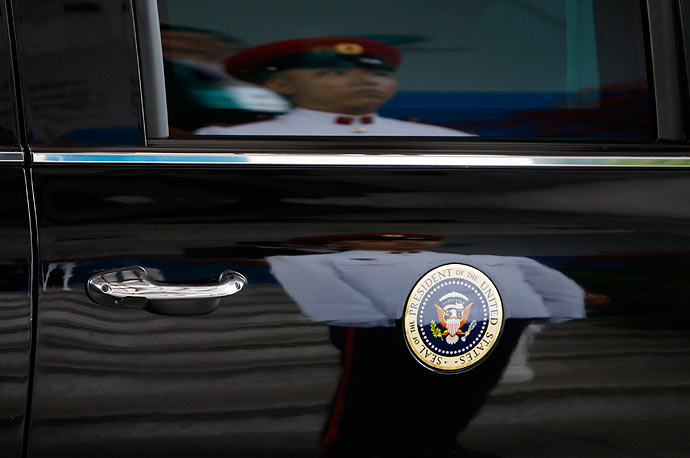 A honor guard is reflected on U.S. President Barack Obama's official car outside the Istana Palace on in Singapore.