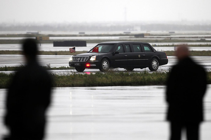 President Barack Obama's car drives off the tarmac at Pudong International Airport in Shanghai.