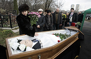 Widow Natalia Zharikova grieves over her husband Sergei Magnitskys body