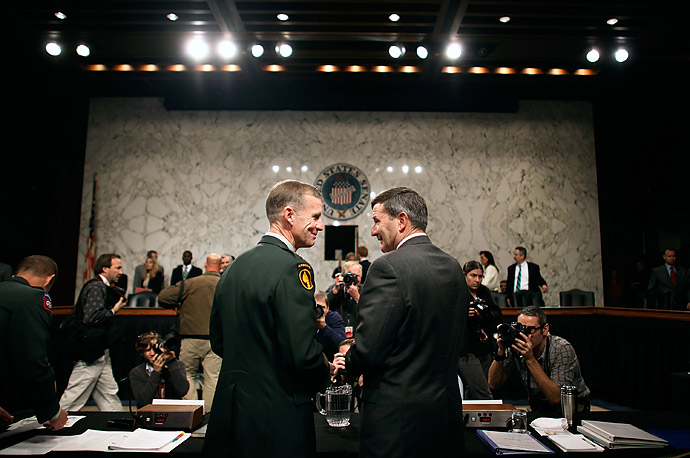 U.S. Army General Stanley McChrystal, left, and Ambassador to Afghanistan Karl Eikenberry share a laugh before testifying to the Senate Armed Services Committee about the war in Afghanistan in Washington, DC.