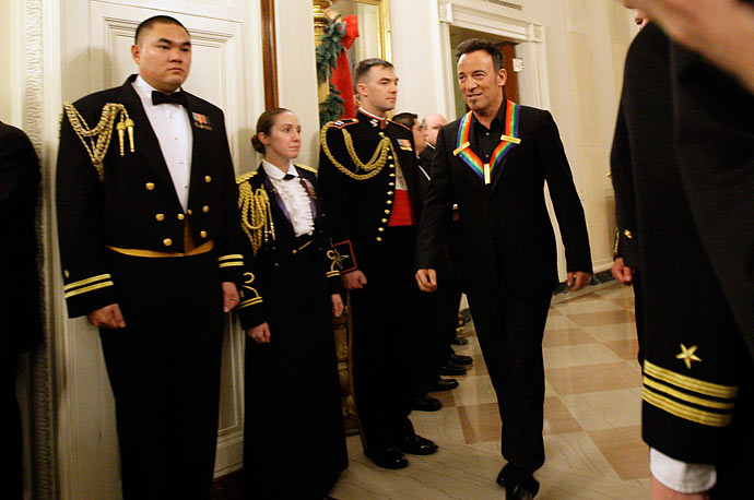 Performing artist Bruce Springsteen enters the East Room of the White House for an event to honor the Kennedy Center honorees.