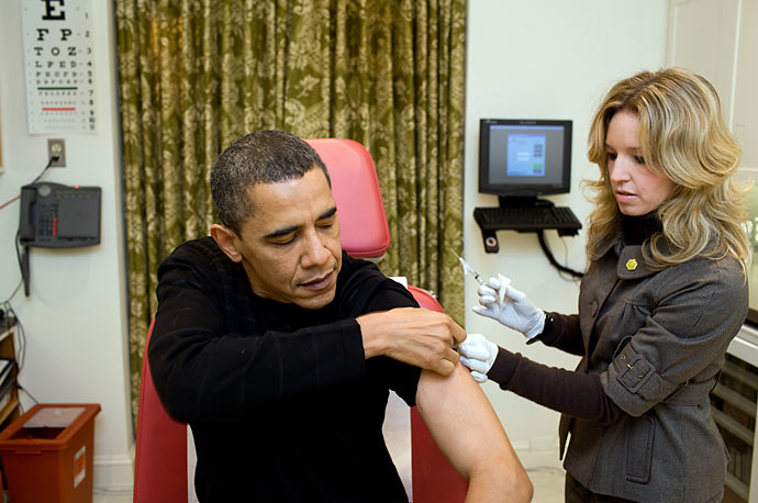 A White House nurse prepares to administer the H1N1 vaccine to President Barack Obama at the White House.