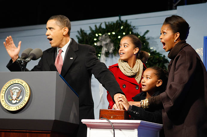 The Obama family reacts as they light the National Christmas Tree on the Ellipse in Washington.