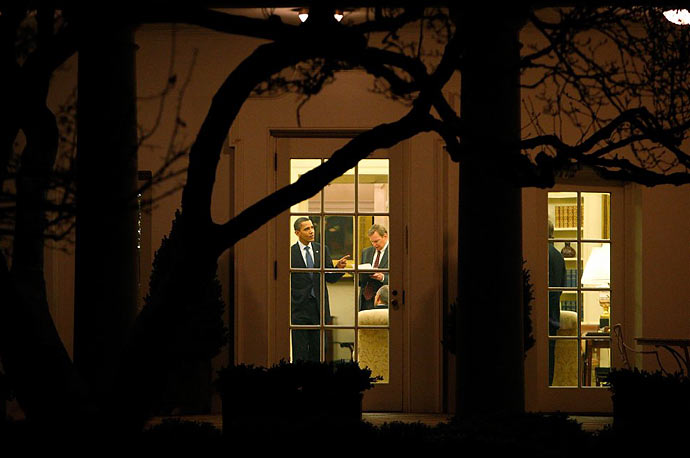 President Barack Obama speaks with his White House staff in the Oval Office prior to his departure to the 2009 United Nations Climate Change Conference in Copenhagen.
