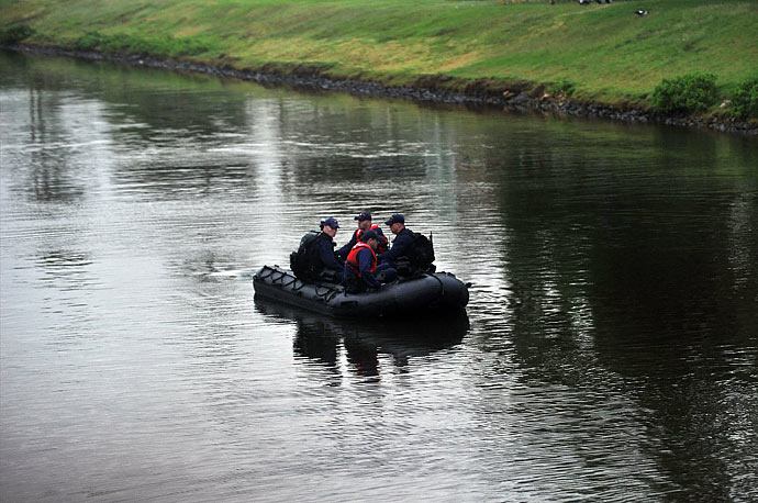 A US Coast Guard security team patrols a canal near the house where President Obama and his family are staying on their vacation in Kailua, Hawaii.