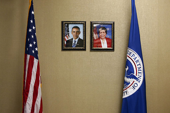 Portraits of President Barack Obama and Secretary of Homeland Security Janet Napolitano hang on a wall at the U.S. Transporation Security Administration (TSA) Systems Integration