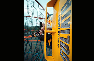 Renee Escolado and Sandra Aguillara of Los Angeles share a kiss as they are turned on their side on a new rollercoaster