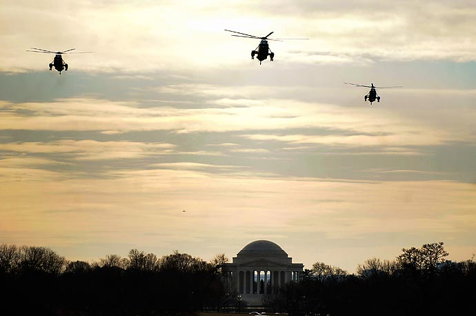 A trio of helicopters, one of which carries President Obama and his family flies over the Jefferson Memorial en route to the White House. The Obamas were returning from their holiday vacation in Hawaii.
