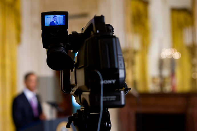 President Barack Obama is visible on a television camera monitor while speaking on the economy and job creation in the East Room of the White House in Washington.