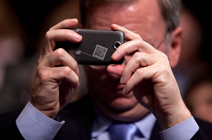 Google CEO Eric Schmidt takes a photo of President Barack Obama with Google's new smartphone, the Nexus One, during the House Democratic Caucus retreat at the U.S. Capitol