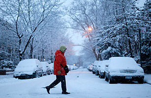 A pedestrian crosses Fuller Place in Brooklyn, New York. Mary Altaffer / AP