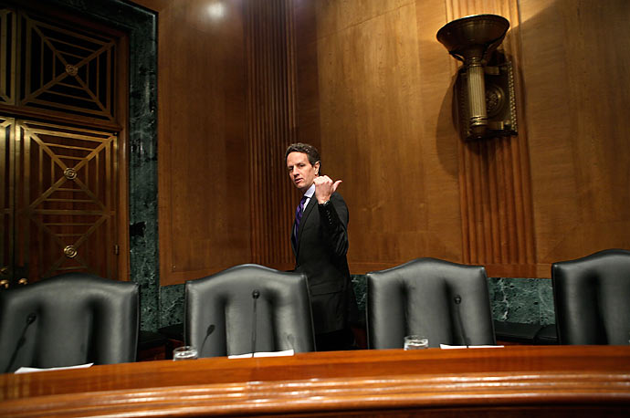 Secretary of the Treasury Timothy Geithner arrives for a hearing before the Senate Finance Committee on Capitol Hill.