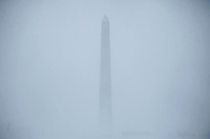 Blowing snow obscures the Washington Monument during a powerful winter storm in Washington, D.C.