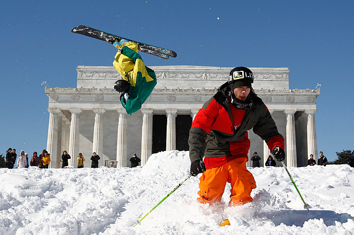 Andy Parry, left, and Will Wesson perform acrobatic ski jumps in front of the Lincoln Memorial in Washington D.C.