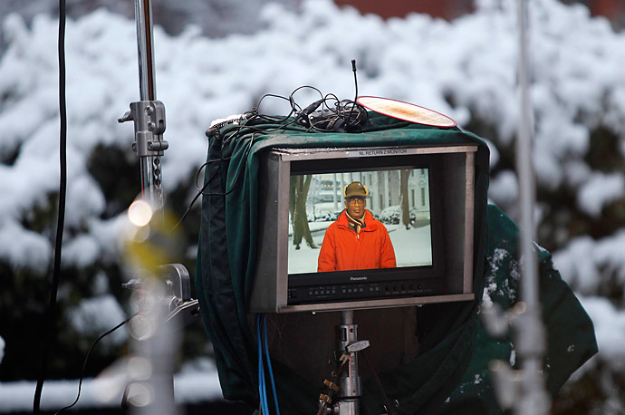Al Roker, the weather anchor for NBC television network's 'Today' program, is pictured live on a tv monitor as he reports on the weather at the White House in Washington, February 3, 2010, following an overnight winter storm.
