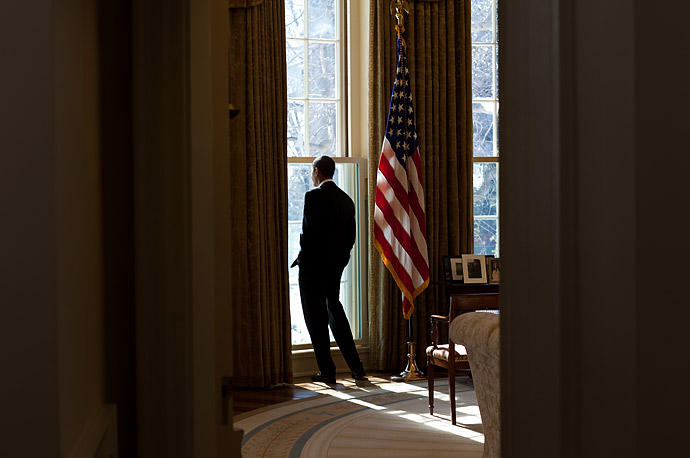 President Barack Obama looks out the window of the Oval Office, Feb. 12, 2010.