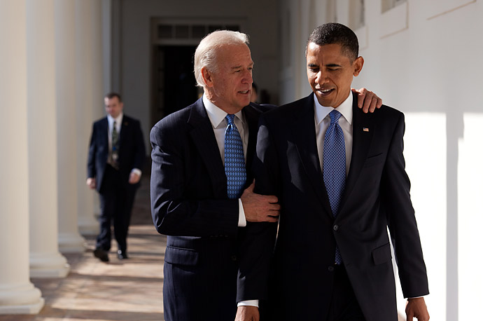 President Barack Obama walks with Vice President Joe Biden along the Colonnade.