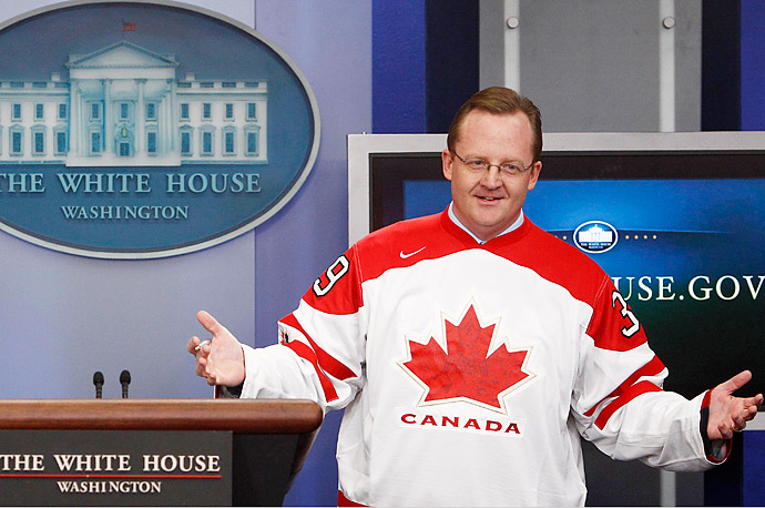 White House Press Secretary Robert Gibbs wears a Canadian Olympic team hockey jersey during his news briefing at the White House.