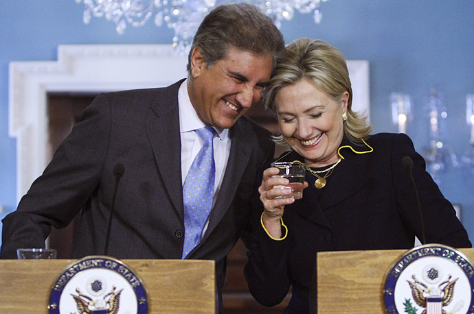 Shah Mehmood Qureshi, the Foreign Minister of Pakistan, shares a laugh with Secretary of State Hillary Rodham Clinton at the State Department in Washington D.C.