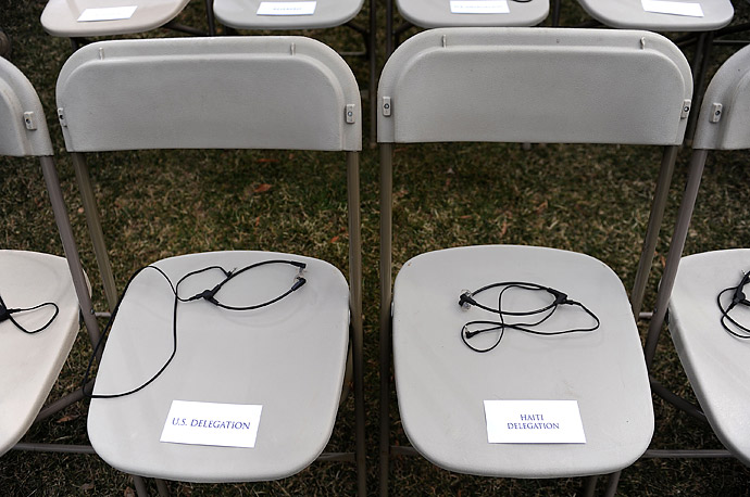 Translation devices sit on seats reserved for members of the U.S. and Haiti delegations prior to a joint statement by President Obama and Haitian President Rene Garcia Preval at the White House.