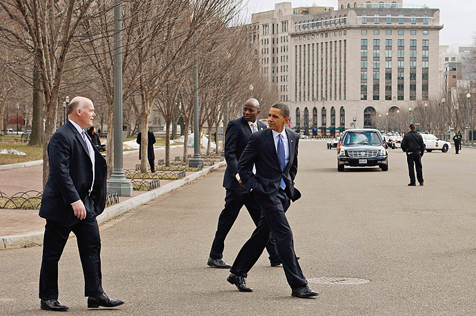 President Barack Obama crosses Pennsylvania Avenue while walking back to the White House after speaking at an event with The America's Promise Alliance.