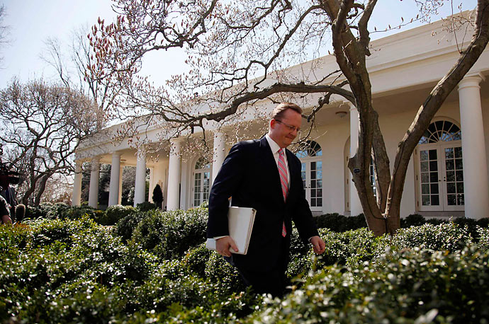 White House Press Secretary Robert Gibbs walks from his daily briefing for the first time in the Rose Garden of the White House in Washington, March 18, 2010.