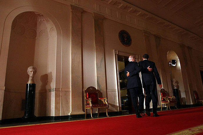 President Barack Obama and Vice President Joseph Biden put their arms around each other after Obama spoke from the East Room of the White House praising the passage of the health care reform legislation