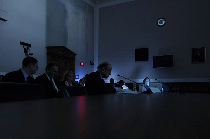 During a power blackout in the Rayburn House Office Building on Capitol Hill in Washington, former Federal Reserve Chairman Alan Greenspan testifies before the Financial Crisis
