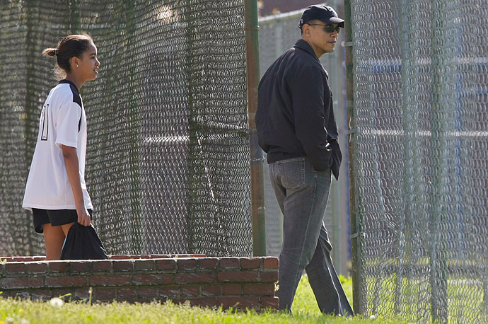 President Obama walks his daughter Malia to a soccer game in Washington.