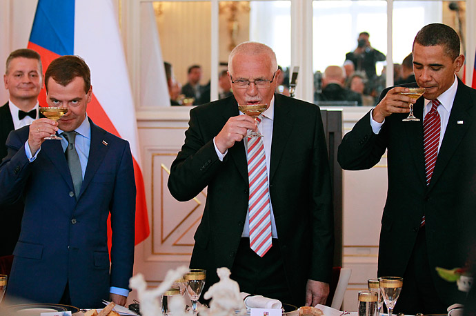 President Barack Obama, along with with Russian President Dmitry Medvedev, left, and Czech Republic President Vaclav Klaus toast at the Prague Castle after signing an nuclear arms control agreement.