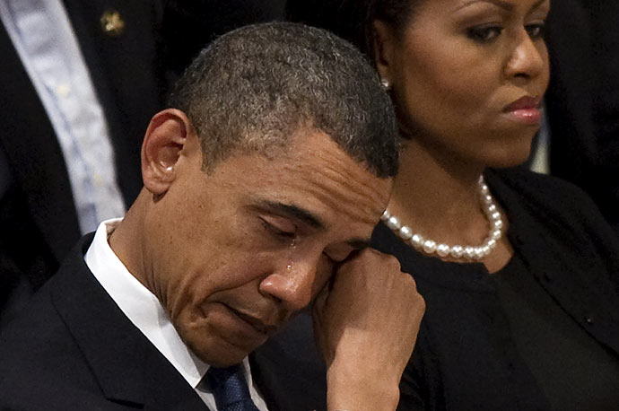 President Barack Obama wipes away a tear as he sits next to First Lady Michelle Obama at the funeral service for Dr. Dorothy Height at Washington