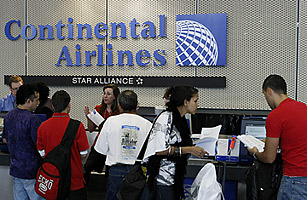 Passengers check in for a Continental Airlines flight in Chicago's O'Hare International Airport