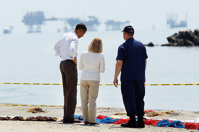 President Barack Obama, left, tours the beach at Port Fourchon, Louisiana with Admiral Thad Allen, right, and Parish President Charlotte Randolph to survey the damage caused by the Deepwater Horizon oil spill.