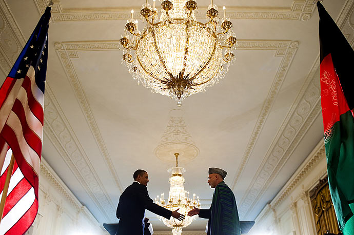 President Barak Obama shakes hands with Afghan President Hamid Karzai during a joint press conference at the White House in Washington, DC, May 12, 2010.