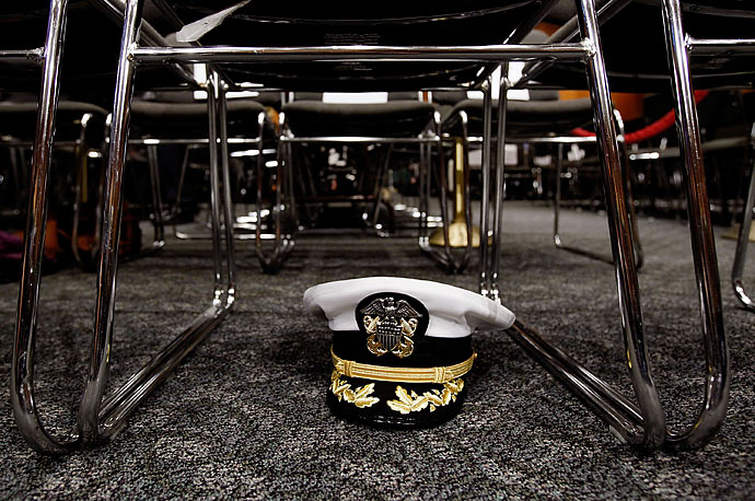 U.S. Chairman of the Joint Chiefs of Staff Admiral Michael Mullen's hat is stowed underneath a chair before he testifies before the Senate Foreign Relations Committee about the new Strategic