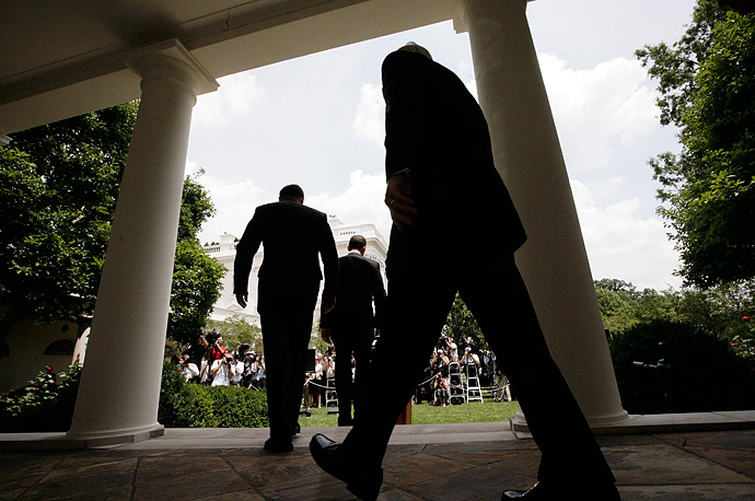 President Barack Obama, followed by Gen. David Petraeus and Defense Secretary Robert Gates, arrive at the Rose Garden of the White House in Washington D.C. to announce that Gen. Petraeus would replace Gen. Stanley McChrystal.