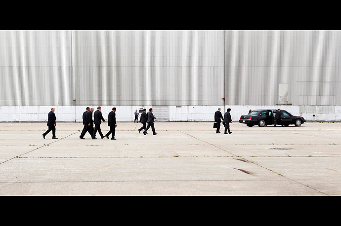 President Barack Obama (2nd L) walks with his entourage toward Smith Electric Vehicles upon his arrival in Kansas City, Missouri on July 8, 2010.