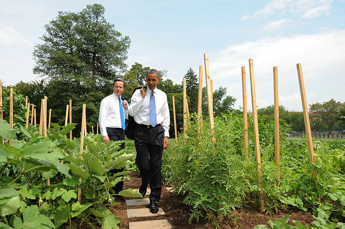 President Obama and British Prime Minister David Cameron walk through the White House garden.