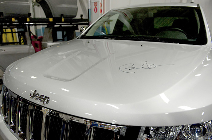 Obama's signature sits on the hood of the 2011 Grand Cherokee at the Chrysler Auto Plant in Detroit, Michigan.
