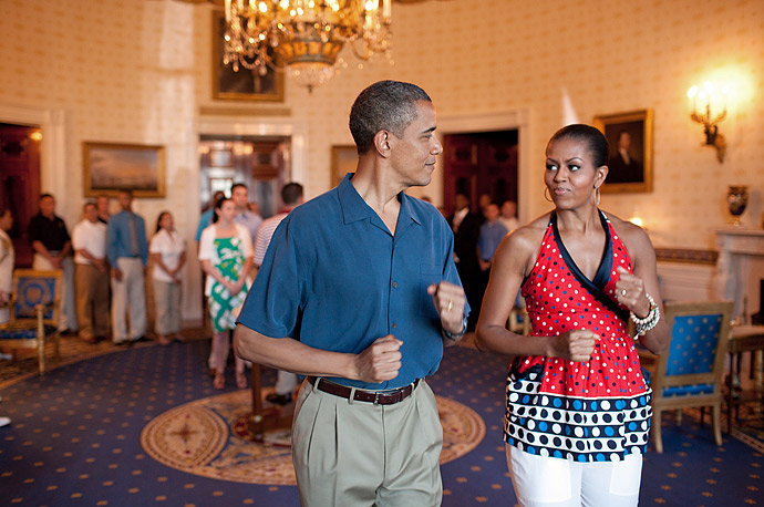 In a photo released by the White House last week, President Obama and First Lady Michelle pretend to march to music in the Blue Room during an Independence Day celebration at the White House.