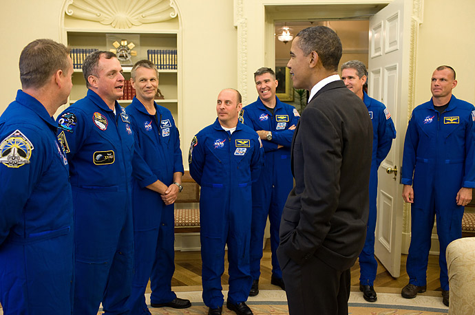 President Obama greets crew members from the Space Shuttle Atlantis and the International Space Station in the Oval Office.