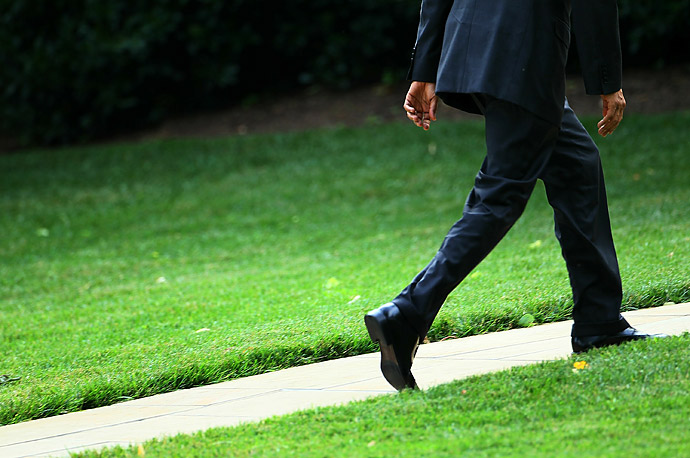 President Barack Obama walks towards the Oval Office after returning from visits to Kansas City, Missouri and Las Vegas, Nevada.