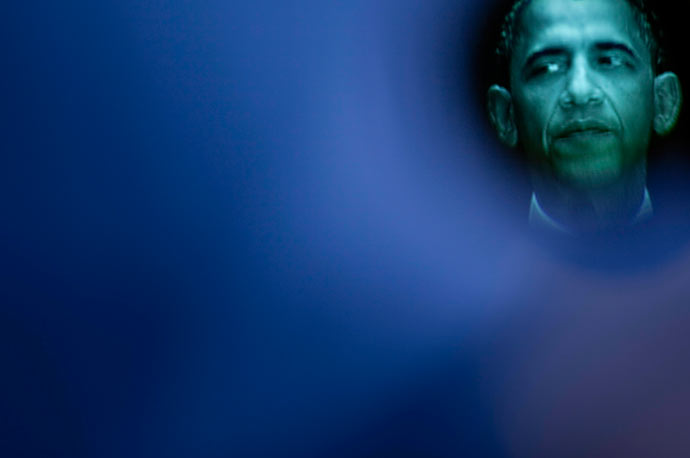President Barack Obama is seen through a viewfinder as he pauses during a speech on immigration reform at American University.