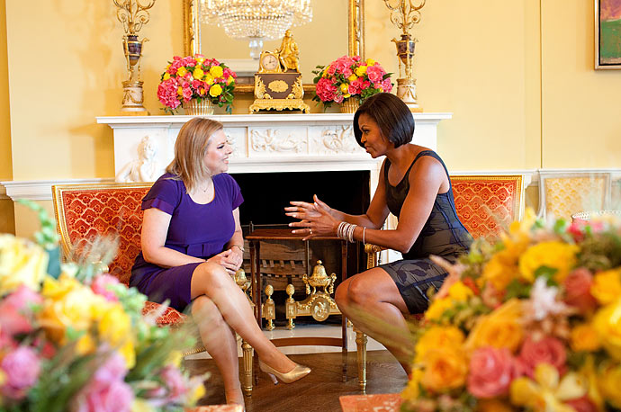 First Lady Michelle Obama has tea with Sara Netanyahu, wife of Israeli Prime Minister Benjamin Netanyahu, in the Yellow Oval Room of the White House, July 6, 2010.